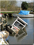 TG3204 : Water-logged boat in Rockland St Mary Staithe by Evelyn Simak
