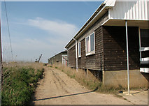 TM4599 : Path past boatyard sheds beside the River Waveney in St Olaves by Evelyn Simak