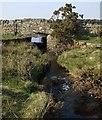 NZ0710 : Road Bridge over stream by Matthew Hatton