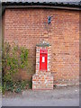 TM3569 : Four Crossways Victorian Postbox by Geographer