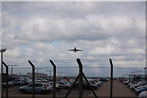 TQ0975 : Hatton Cross staff carpark and British Airways 747 on take-off by Roger Davies