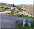 NM8263 : Telephone box at the junction by Russel Wills