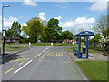 SJ5114 : Bus stops and roundabout at the southern end of Meadow Farm Drive by Richard Law
