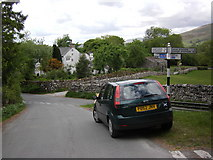 SD7186 : Road junction near Howgill bridge by Peter Bond