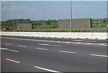 O1069 : Windbreaks on the M1 north of the Balgeen Toll Plaza by Eric Jones