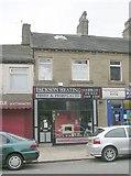 SE0724 : Jackson Heating - King Cross Road by Betty Longbottom