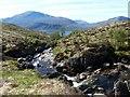 NG9904 : Downstream along Coire nan Eiricheallach by Alan Reid