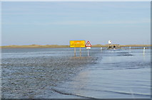 NU0842 : Holy Island causeway - tide coming in fast by Nicholas Mutton