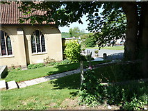 TQ4563 : Shadows in the churchyard just off Worlds End Lane by Basher Eyre