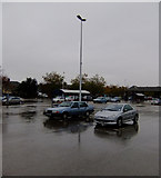 TA2609 : Sainsbury's Car Park on a Wet Wednesday Afternoon by David Wright