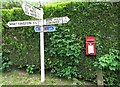 SJ3333 : Postbox and Road sign in Hindford by Linnet