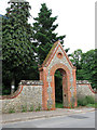 TF8709 : Entrance to All Saints' churchyard from School Road by Evelyn Simak