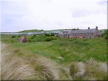 NU1535 : Heather Cottages, Budle Bay by Andrew Curtis