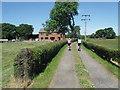SJ6497 : Track at Yates' Farm, Pennington by Anthony Parkes