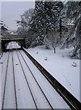 ST7565 : Railway and park in snow by Neil Owen