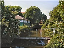 TQ6200 : Cottage beside stream in Princes Park by Paul Gillett