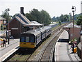 SX8499 : Train for Exeter stands at Crediton Station by Roger Cornfoot