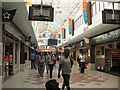 TQ2775 : Shopping arcade at Clapham Junction station by Stephen Craven