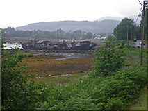 NM5643 : Two wrecked ships on mudflats north of Salen  by C Michael Hogan
