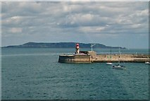 O2429 : Dun Laoghaire's East Pier Lighthouse with the Head of Howth in the background by Eric Jones