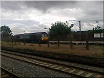 SP0278 : Freight train passing Northfield station by Andrew Abbott