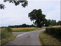 TM3662 : Junction on the road to Silverlace Green by Adrian Cable