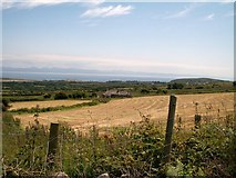 SH3033 : The derelict Tyddyn-yr-haint surrounded by harvested hay fields by Eric Jones