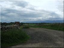 NY6714 : Entrance to Howe Slacks Farm by David Brown