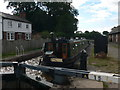 SJ5759 : Canal boat about to descend Bunbury Locks by Eirian Evans