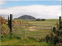 SH2435 : View across farmland towards Tre-garnedd farm by Eric Jones
