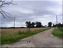 TM4163 : Footpath to Knodishall Green Church (remains) & entrance to Westhouse Farm by Adrian Cable