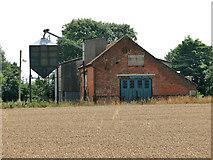 TG1301 : Barn and silo at Brick Kiln Farm by Evelyn Simak