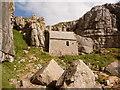 SR9692 : St. Govan's Head: the chapel nestles by Chris Downer