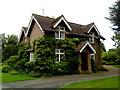 TQ1628 : Cottage near Denne Park by Andrew Abbott