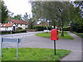 TM1359 : A1120 junction with Quoits Meadow & Quoits Meadow Postbox by Adrian Cable