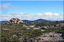 NH9506 : Cairn below Castle Hill by Colin Kinnear