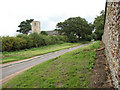 TF8730 : Unnamed lane past St Peter's church in Dunton by Evelyn Simak