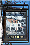 SK8975 : The Sun Inn sign by Richard Croft