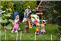 SU8194 : Colourful scarecrows on the allotments by Steve Daniels