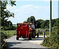 ST9356 : 2010 : Tractor with trailer near Old Hurst Farm by Maurice Pullin