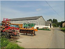 TF9608 : Agricultural implements at Elm Farm, Thorpe Row by Adrian S Pye