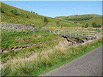 NT8511 : Footbridge and sheepfold by the Rowhope Burn by Oliver Dixon