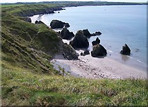 SH2035 : Sea stacks at the northern end of Traeth Penllech beach by Eric Jones