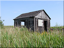 TM4599 : Disused permanent way hut beside the railway by Glen Denny