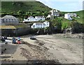 SW9980 : Looking West across the harbour. Port Isaac by Derek Voller
