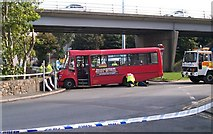SH4862 : Mopping up after a major road accident at the approach to the Caernarfon Bus Station by Eric Jones