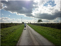 TA1343 : A jogger on Whins Lane by Ian S