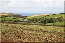 SW9979 : North Cornwall Coast in the distance by roger geach