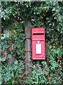 TG1340 : ER postbox in Sheringham Road, West Beckham by Evelyn Simak