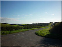 SE9346 : The road to Holme on the Wolds by Ian S